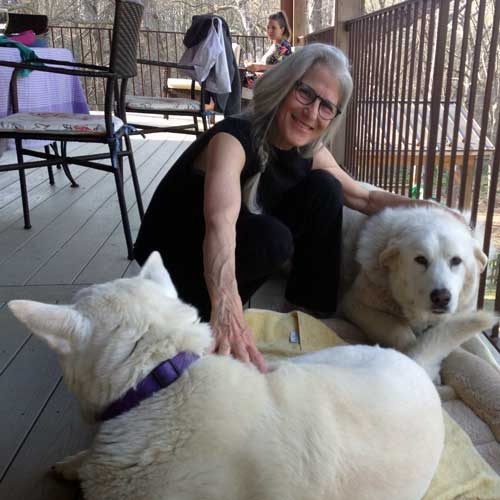 Zohara with two of her dogs, camera-shy Bella in front, and Omaha